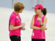 Heather Collins, left, talks with event coordinator Lisa Helland, right, of Cedar Falls, following the 5K Run/Walk/Ride/Stroll/Roll for two missing Iowa cousins, Lyric Cook-Morrissey, 10, and Elizabeth Collins, 8, in Waterloo, Iowa on Saturday, July 21, 2012. Investigators reclassified the disappearance of two missing Iowa cousins as an abduction case Friday after an FBI dive team failed to find their bodies in a lake near where they were last seen a week ago. (AP Photo/Waterloo Courier, Dawn J. Sagert)