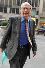 FILE - In this July 22, 2011 file photo, Chairman and Chief Executive Officer of News Corporation Rupert Murdoch enters the News Corp. building, in New York. Media mogul Rupert Murdoch has resigned from a number of News Corp. subsidiary boards in Britain and the United States, a spokeswoman confirmed Saturday, July 21, 2012. (AP Photo/Louis Lanzano, File)
