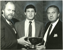 Tribune File Photo Jim L. Buckley, regional manager for TVGuide, Steve Young, and Fred S. Ball. Young was awarded Sportsman of the Year, Jan. 26, 1984.