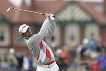 Adam Scott of Australia plays a shot on the second fairway at Royal Lytham & St Annes golf club during the third round of the British Open Golf Championship, Lytham St Annes, England, Saturday, July 21, 2012. (AP Photo/Peter Morrison)
