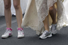 Brides prepare for a race in central Belgrade, Serbia, Sunday, July 22, 2012. The winner and two runners-up of the Bridal Race, organized by a local magazine, receive numerous awards, including the wedding gown they had chosen to race in. (AP Photo/Darko Vojinovic)