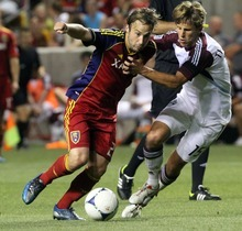 Rick Egan  | The Salt Lake Tribune   Real Salt Lake midfielder Ned Grabavoy (20) tries to get by Wells Thompson (15) of the Rapinds, in MLS action Real Salt Lake vs the Colorado Rapids, Saturday, July 21, 2012.