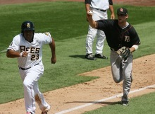 Kim Raff | The Salt Lake Tribune Salt Lake Bees player Vernon Wells is tagged out in a rundown with Fresno Grizzlies player Conor Gillaspie at Spring Mobile Ballpark in Salt Lake City, Utah on July 22, 2012.