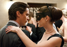 This undated film image released by Warner Bros. Pictures shows Christian Bale as Bruce Wayne, left, and Anne Hathaway as Selina Kyle in a scene from the action thriller