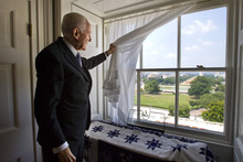 In this Monday, July 16, 2012 photo, Sen. Orrin Hatch, R-Utah, looks out of a window in a small private office at the Capitol in Washington. With his re-election to a seventh term all but assured, Hatch can think about his legacy. He's very clear about what he wants: a deal that restructures the tax code while also slowing and even stopping the government's accumulation of debt. To get it, he says he'll practice the art of compromise. (AP Photo/Cliff Owen)