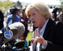 Carol Chambers, district attorney for the 18th Judicial District, speaks during a media availability after a court appearance by James Holmes at the Arapahoe County Courthouse, Monday, July 23, 2012, in Centennial, Colo. Twelve people were killed and dozens were injured in a shooting attack early Friday at a packed theater during a showing of the Batman movie,