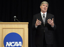 NCAA President Mark Emmert gestures during a news conference in Indianapolis, Monday, July 23, 2012. The NCAA has slammed Penn State with an unprecedented series of penalties, including a $60 million fine and the loss of all coach Joe Paterno's victories from 1998-2011, in the wake of the Jerry Sandusky child sex abuse scandal.  (AP Photo/Michael Conroy)