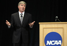 NCAA President Mark Emmert gestures during a news conference in Indianapolis, Monday, July 23, 2012. The NCAA has slammed Penn State with an unprecedented series of penalties, including a $60 million fine and the loss of all coach Joe Paterno's victories from 1998-2011, in the wake of the Jerry Sandusky child sex abuse scandal.  (AP Photo/Michael Conroy