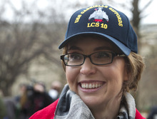 Former Arizona Rep. Gabrielle Giffords attends a ceremony at the Pentagon, Friday, Feb. 10, 2012, for the unveiling of the USS Gabrielle Giffords. The Navy has named a ship for Gabrielle Giffords, the recently retired congresswoman from Arizona who is recovering from a gunshot wound to the head received in January 2011. (AP Photo Manuel Balce Ceneta)