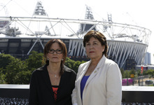 Israelis Ilana Romano, left, and Ankie Spitzer, widows of two Israeli Olympians killed by Palestinian gunmen at the 1972 Munich Olympics, pose for photographers in front of the Olympic Stadium ahead of the 2012 Summer Olympics, Wednesday, July 25, 2012, in London.  Relatives of the victims are calling on spectators to stage a silent protest during the opening of the London games, but the International Olympic Committee says the opening ceremony is not an appropriate arena to remember the dead, despite pressure from politicians in the United States, Israel and Germany. (AP Photo/Lefteris Pitarakis)