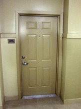 This July 13, 2011, photo shows the door to to apartment in a complex in New Brunswick, N.J., that was rented by an undercover NYPD officer. On June 2, 2009, a building superintendent at the complex just off the Rutgers University campus called 911 after stumbling one of the NYPD's biggest secrets - a safe house, a place where undercover officers working well outside the department's jurisdiction could lay low and coordinate surveillance. The Associated Press has obtained a copy of the 911 call that exposed the NYPD safe house. In 2011, the AP requested a copy of the 911 tape. The New Brunswick Police refused. After the AP sued, the city turned over the tape and emails this week that described the NYPD's efforts to keep the recording a secret. (AP Photo/Matt Apuzzo)