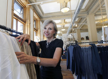 Al Hartmann  |  The Salt Lake Tribune   The Chalk Garden is being reborn at 74 South Main Street.  Store Manager Debbie Kotter Barkley sets up clothing displays Wednesday July 25.  It sits at the northwest corner of 100 South and Main Street in an old bank building.