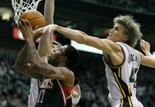 Milwaukee Bucks small forward Chris Douglas-Roberts (17) is fouled by Utah Jazz small forward Andrei Kirilenko (47) of Russia during the first half of an NBA basketball game in Salt Lake City, Monday, Nov. 29, 2010. (AP Photo/Colin E Braley)