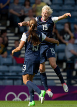 United States' Megan Rapinoe, right, leaps onto United States' Alex Morgan in celebration after Morgan scores a goal during the women's group G soccer match between the United States and France at the London 2012 Summer Olympics, Wednesday, July 25, 2012, at Hampden Park Stadium in Glasgow, Scotland. (AP Photo/Chris Clark)