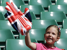 A child shows her support for Great Britain prior to the start of the women's group E soccer match between Great Britain and New Zealand, at the Millennium Stadium in Cardiff, Wales, at the 2012 London Summer Olympics, Wednesday, July 25, 2012. (AP Photo/Luca Bruno)