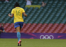 Brazil's Renata Costa, celebrates after scoring during the women's group E soccer match between Brazil and Cameroon, at the Millennium stadium in Cardiff, Wales, at the 2012 London Summer Olympics, Wednesday, July 25, 2012, in Cardiff. (AP Photo/Luca Bruno)