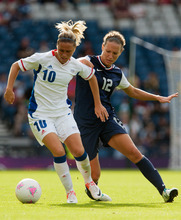 France's Camille Abily, left, shields the ball from United States' Lauren Cheney during the women's group G soccer match between the United States and France at the London 2012 Summer Olympics, Wednesday, July 25, 2012, at Hampden Park Stadium in Glasgow. (AP Photo/Chris Clark)
