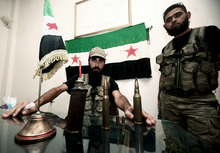 In this Tuesday, July 24, 2012 photo, Free Syrian Army soldiers are seen at the border town of Azaz, some 20 miles (32 kilometers) north of Aleppo, Syria. Turkey sealed its border with Syria to trucks on Wednesday, July 25, 2012 cutting off a vital supply line to the embattled nation as fighting stretched into its fifth day in the commercial capital of Aleppo. (AP Photo/Turkpix)