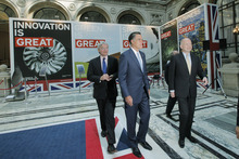 Republican presidential candidate and former Massachusetts Gov. Mitt Romney, center, tours the GREAT Pavillion Exhibit with British Foreign Secretary William Hague, right, and British Secretary of State for International Development Andrew Mitchell in London, Thursday, July 26, 2012. (AP Photo/Charles Dharapak)