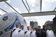 MLS All-Stars, and Chelsea FC players from left, MLS' Thierry Henry, captain Dwayne DeRosario, coach Ben Olsen, and Landon Donovan and Chelsea FC's Frank Lampard, John Mikel Obi, and manager Robert Di Matteo line up for a photo in front of a large signed inflated soccer ball at a news conference at the Independence Visitor Center, Tuesday, July 24, 2012, in Philadelphia. The MLS All-Stars and Chelsea FC will play against each other in Chester, Pa., on Wednesday. (AP Photo/Brynn Anderson)