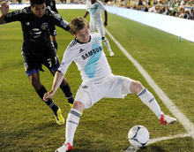 Chelsea FC's Marko Main, right, of Germany, works the ball around MLS All-Stars' Steven Beitashour, of the San Jose Earthquakes, during the first half of soccer's MLS All-Star game, Wednesday, July 25, 2012, in Chester, Pa. (AP Photo/Michael Perez)