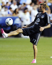 MLS All-Stars' David Beckham, of the Los Angeles Galaxy, warms up before soccer's MLS All-Star game against Chelsea FC, Wednesday, July 25, 2012, in Chester, Pa. (AP Photo/Michael Perez)