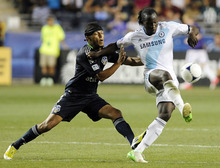 Chelsea FC's Romelu Lukaku, right, of Belgium, drives the ball past MLS All-Stars' Carlos Valdes during the second half of soccer's MLS All-Star game, Wednesday, July 25, 2012, in Chester, Pa. The MLS All-Stars won 3-2. (AP Photo/Michael Perez)