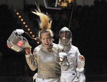 Mariel Zagunis, left, of the United States, will carry the American flag in Friday's Olympics Opening Ceremony. She is pictured here celebrating after winning a women's individual sabre, round 16 qualifying match, against Japan's Seira Nakayama at the World Fencing Championship in Catania, Italy, Wednesday, Oct. 12, 2011. (AP Photo/Carmelo Imbesi)