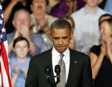 President Barack Obama prepares to address supporters during a campaign stop in Fort Myers, Fla., Friday, July 19, 2012. Obama said the tragic movie theater shooting in Colorado that left 12 people dead is a reminder that life is fragile. He says the event