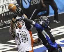 Utah Blaze's Tysson Poots (19) gets a pass deflected from his hands by San Antonio Talons' Kenneth Fontenette during the first half of an Arena Football League playoff game in San Antonio on Friday, July 27, 2012. (AP Photo/San Antonio Express-News, Kin Man Hui)  MAGS OUT  NO SALES  SAN ANTONIO OUT