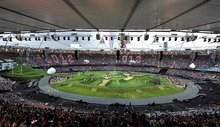 The Olympic Stadium prepares for the Opening Ceremony of the 2012 Summer Olympic Games on Friday, July 27, 2012, in London.  (AP Photo/Martin Rickett, PA)  UNITED KINGDOM OUT NO SALES NO ARCHIVE