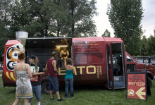 Kim Raff | The Salt Lake Tribune People line up to order food at the Bento Truck during the Twilight Concert Series at Pioneer Park in Salt Lake City on July 19, 2012.