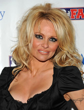 FILE - This Feb. 4, 2011 file photo shows actress Pamela Anderson arriving to host the Dallas SuperBash 2011 Super Bowl party at the Fashion Industry Gallery in Dallas, Texas.  ABC says an
