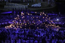 Lighting of the Olympic Cauldron takes place in the middle of the infield during opening ceremonies  Friday, July 27 2012 at Olympic Stadium. John Leyba, The Denver Post