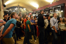 Crowds focus on a television set at the Vault bar in London as the United States team enters the stadium at Olympic Park during the opening ceremonies of the 2012 London Olympic Games Friday evening, July 27, 2012. (Karl Mondon/Bay Area News Group)