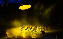 Dancers perform during Opening Ceremonies in the Olympic Stadium for the London 2012 Olympics at Olympic Park in London, England on Friday night, July 27, 2012.  (Nhat V. Meyer/Staff)