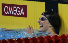Missy Franklin reacts after winning the women's 100-meter backstroke final at the U.S. Olympic swimming trials, Wednesday, June 27, 2012, in Omaha, Neb. (AP Photo/Mark Humphrey)