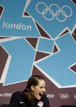 U.S. swimmer Missy Franklin reacts during news conference at the 2012 Summer Olympics, Thursday, July 26, 2012, in London. (AP Photo/Ng Han Guan)