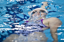 The United States' Missy Franklin swims during a practice session at the Aquatics Center at the Olympic Park ahead of the 2012 Summer Olympics, Thursday, July 26, 2012, in London. Opening ceremonies for the 2012 London Olympics will be held Friday, July 27. (AP Photo/Daniel Ochoa de Olza)