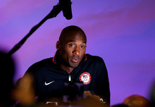United States basketball player Kobe Bryant speaks to reporters during a news conference at the Olympic Park, Friday, July 27, 2012, in London. The 2012 Summer Olympics begin with opening ceremonies on Friday.  (AP Photo/Stephen Pond, PA) UNITED KINGDOM OUT; NO SALES; NO ARCHIVE