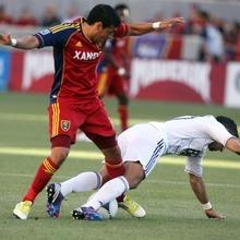 Kim Raff | The Salt Lake Tribune Real Salt Lake player (left) Javier Morales trips up Vancouver player Camilo (cq) at Rio Tinto Stadium in Sandy, Utah on July 27, 2012.