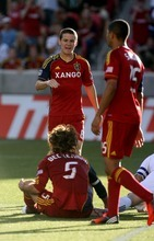 Kim Raff | The Salt Lake Tribune Real Salt Lake player Will Johnson celebrates with (ground) Kyle Beckerman after a call in the box that lead to a penalty kick against Vancouver at Rio Tinto Stadium in Sandy, Utah on July 27, 2012.