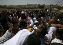 People carry the body of a six year old Syrian boy Bilal El-Lababidi during his funeral in Ramtha, Jordan, Friday July 27, 2012. The boy was shot dead by Syrian army as his parents and a dozen other refugees tried to cross a border to seek refuge in Jordan, his mother said. (AP Photo/Mohammad Hannon)