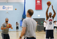 (AP Photo/Jae C. Hong) United States' Deron Williams, front, and Carmelo Anthony joke around during a men's team basketball practice at the 2012 Summer Olympics, Saturday, July 28, 2012, in London.