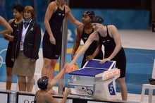 Missy Franklin shakes hand with teammate Allison Schmitt after capturing the Bronze  in the Women's 4 x 100m Freestyle Relay during the evening session of the swimming competition Saturday, July 28, 2012 at the Aquatics Centre. Missy swam the first leg of the relay.   John Leyba, The Denver Post