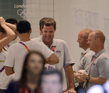Missy Franlin's coach Todd Schmitz was all smiles in the hallway after the Women's 4 x 100m Freestyle Relay during the evening session of the swimming competition Saturday, July 28, 2012 at the Aquatics Centre.  The team raced to a Bronze Medal and the first for Missy Franklin. John Leyba, The Denver Post