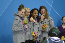 Missy Franklin, Jessica Hardy, Lia Neal and Allison Schmitt pose with their Bronze Medals in the Women's 4 x 100m Freestyle Relay during the evening session of the swimming competition Saturday, July 28, 2012 at the Aquatics Centre.  John Leyba, The Denver Post