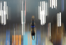 A competitor dives during a practice session at the Aquatics Centre in the Olympic Park ahead of the 2012 Summer Olympics in London, Friday, July 27, 2012. (AP Photo/Mark J. Terrill)