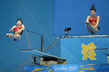 Wu Minxia of China, left, and He Zi compete during the 3 Meter Synchronized Springboard final at the Aquatics Centre in the Olympic Park during the 2012 Summer Olympics in London, Sunday, July 29, 2012. China won the gold medal in the event. (AP Photo/Mark J. Terrill)