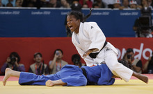 North Korea's An Kae Um competes with Cuba's Acosta Bermoy, right, during the gold medal match in the women's 52-kg judo competition at the 2012 Summer Olympics, Sunday, July 29, 2012, in London. (AP Photo/Paul Sancya)